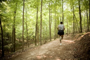 Man running in woods, rear view