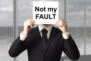 businessman hiding face not my fault